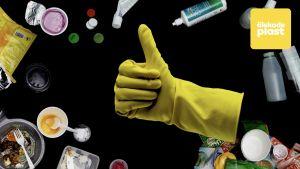 Gul gummihandske visar tummen upp.