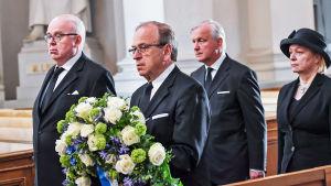 Chefdirektör Erkki Liikanen, bankdirektör Seppo Honkapohja och direktionsmedlemmarna Olli Rehn och Merja Nykänen representerade Finlands Bank vid Mauno Koivistos begravning den 25 maj 2017.