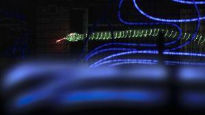 graafinen kuva vihreästä käärmeestä