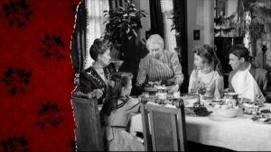 En familj vid matbordet, ur gammal finska film