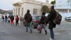 Syriska flyktingar på gatan i Leros, Grekland i oktober 2014.