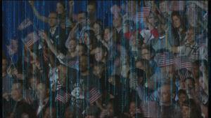 Ihmisiä heiluttamassa USA:n lippua poliittisessa tilaisuudessa.