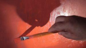Närbild av målande hand