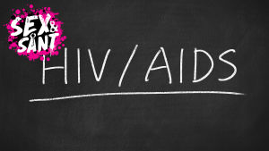 hiv och aids skrivet med krita på en svart tavla