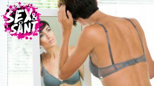 en kvinna i sina bh:n som står och speglar sig i en spegel