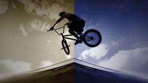 bmx-pyöräilijä ilmassa