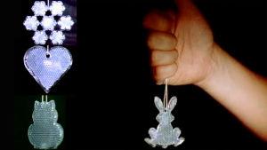 Reflexer med motiven snöflinga, hjärta, katt och kanin hänger.