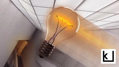 Hehkulamppu syttyy museon aulassa.