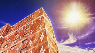 Kuvituskuva: kerrostalo, jonka ulkoseinät on päällystetty kuvitteellisella perovskiittipaneelilla.