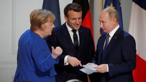 Angela Merkel, Emmanuel Macron ja Vladimir Putin