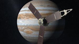 Piirros Juno-luotaimesta Jupiterin luona.