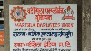 """En skylt där det står """"Wärtsilä employees union""""."""