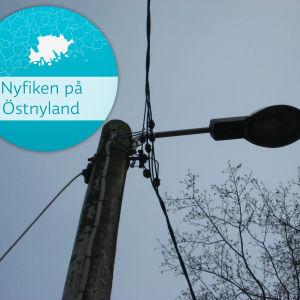 väglampa med Nyfiken-på-Östnyland-logo