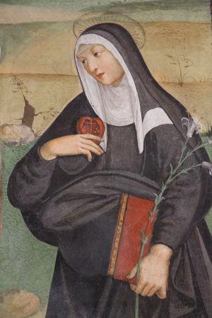 San Gimignano Italia, Pyhä Katariina Sienalainen antaa sydämensä Jeesukselle. Tuntemattoman tekijän seinämaalaus 1400-luvun lopusta.