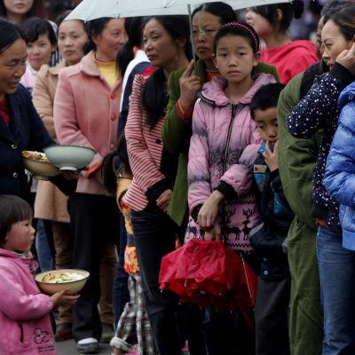 Överlevande från jordbävningen som drabbade landskapet Sichuan i Kina i april 2013.