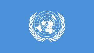 YK:n lippu, sinisellä pohjalla valkoinen kuvio