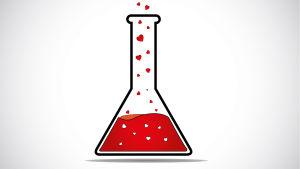 Sydämiä laboratoriopullossa.