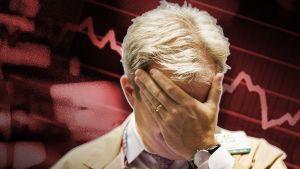 En desperat börsförmedlare täcker sitt ansikte