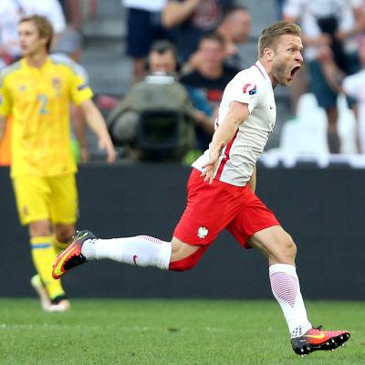 Jakub Blaszczykowski jublar efter sitt mål mot Ukraina.