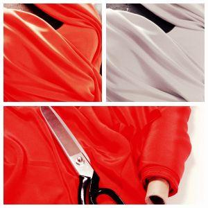 Sakset ja punaista kangasta