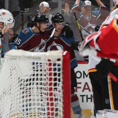 Joonas Donskoi #72 of the Colorado Avalanche celebrates a goal against the Calgary Flames with teammate Andre Burakovsky