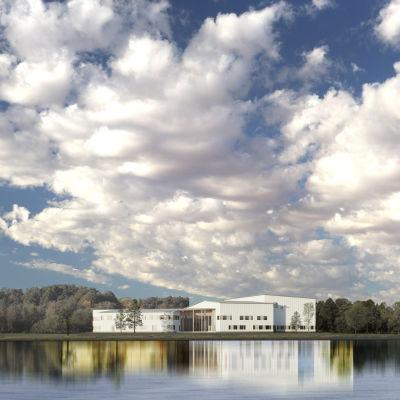 Havainnekuva Ivalon koulukeskuksesta Ivalojoen rannalla