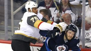 Ryan Reaves tacklar Joel Armia.