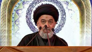 Ahmad Al-Safi, representant för Iraks shiamuslimska ledare, läser upp ett meddelande från storajatollan Ali Sistani