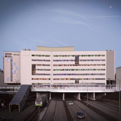 En bild på hur det nya Fyrsjukhuset vid ÅUCS ska se ut, en vit byggnad med färgglada fönsterkarmar.