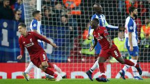 Roberto Firmino och Naby Keita firar Liverpools mål.