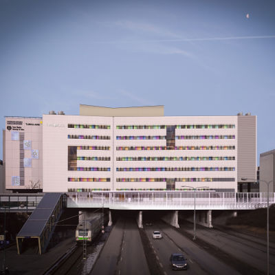 En stor byggnad med många våningar som sträcker sig över en motorväg