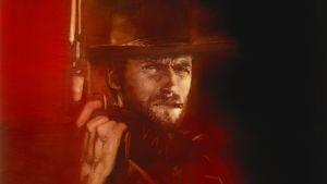 Cowboyn näköinen Clint Eastwood punasävyisessä piirroksessa.
