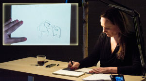 Maren Uthaug tecknar live inför publik. Ruta i hörnet med bilden,