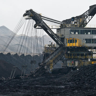 A file photograph showing a bucket dredger produces brown coal in Jaenschwalde, Germany, 01 January 2014. Reports on 30 October 2014 state that the Swedish energy company Vattenfall is considering the disposal of its German brown coal branch in the
