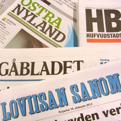KSF Medias olika tidningar utspridda på en yta.