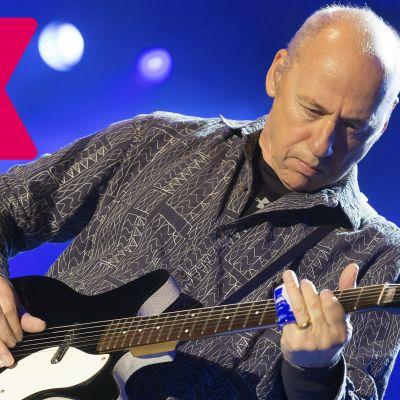 Mark Knopfler spelar elgitarr.