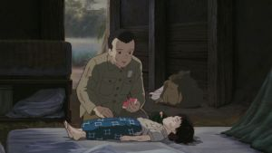 Tulikärpästen hauta -elokuvan kohtaus, jossa päähenkilö hoitaa pikkusiskoaan heidän majassaan.