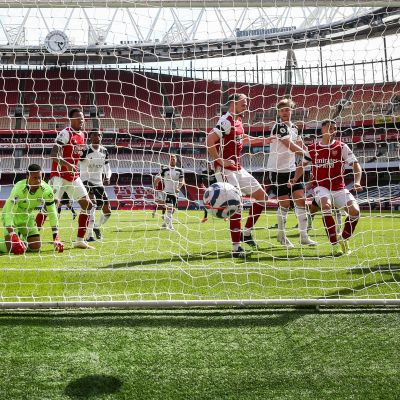 Eddie Nketiah (R) of Arsenal scores the 1-1 equalizer during the English Premier League soccer match between Arsenal FC and Fulham FC in London, Britain, 18 April 2021