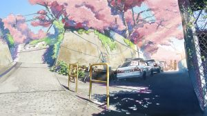 Kuva elokuvast 5 senttimetriä sekunnissa. Kuvassa on tyhjä, aurinkoinen japanilainen risteys jossakin esikaupunkialueella. Kirsikkapuut kukkivat.