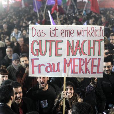 Syrizaanhängare firar valsegern i Aten 25.1.2015.