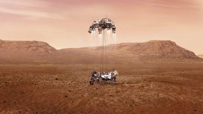 En vision av laboratoriefarkosten Perseverance då det släpps ned på Mars yta.