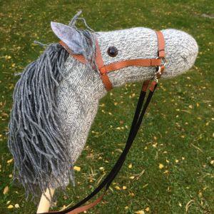 Handgjord grå käpphäst