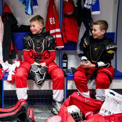 Vityaz Moscow Region's players in a locker room after their victory in the 13th Gazprom Neft Cup International Kids' Hockey Tournament Super Final match between Torpedo Nizhny Novgorod and Vityaz Moscow Region at Bolsh​oy Ice Dome