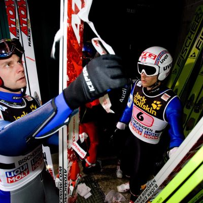 Janne Ahonen of Finland (L) and Björn Einar Romören of Norway during Trial round of the FIS Ski Jumping World Cup event of the 58th Four Hills ski jumping tournament, on January 6, 2010 in Bischofshofen.