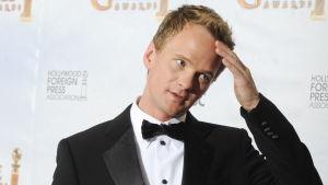 Neil Patrick Harris poserar för fotografer på de 67e Golden Globe Awards i Los Angeles
