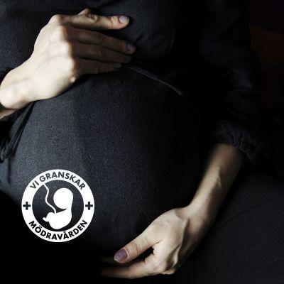 Gravid mage med vattenstämpel på.