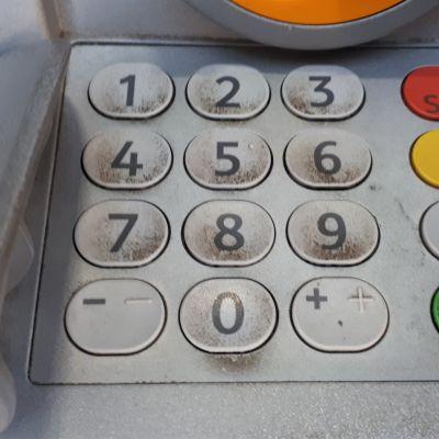 Likauset pankkiautomaatin näppäimet
