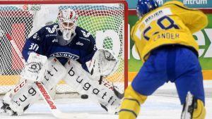 Kevin Lankinen räddar ett skott från svenska spelaren Anton Lander.
