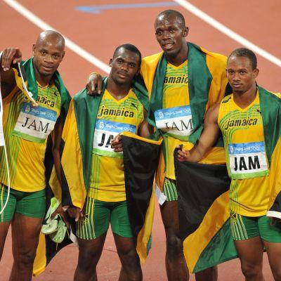 Asafa Powell, Nesta Carter, Usain Bolt och Michael Frater tappar guldet från Peking-OS.