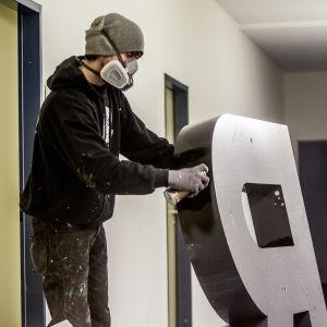 Graffitikonstnär i THE HAUS